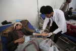A man is treated for suspected cholera infection at a hospital in Sanaa, Yemen in May.