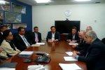 Massoud Karbasian (1R), sitting across his Indonesian counterpart Sri Mulyani Indrawati in Washington, DC.