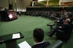 President Hassan Rouhani addresses the parliament on Aug. 15.