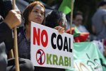 A woman protests a planned coal-fired plant  in southern Thailand.