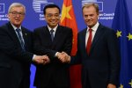 Chinese Premier Li Keqiang (C) shakes hands with Jean-Claude Juncker (L) and Donald Tusk after the meeting in Beijing on Monday.