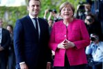 Emmanuel Macron (L) and Angela Merkel in Meseberg, Germany, Tuesday.