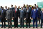 Front row, L-R: Kenya's President Uhuru Kenyatta, Guinea's President Alpha Conde, US President Donald Trump, Italian Prime Minister Paolo Gentiloni, French President Emmanuel Macron, Niger's President Mahamadou Issoufou and Tunisian President Beji Caid Essebsi pose for a family photo  with other participants of the G7 summit, on May 27 in Taormina, Sicily.