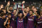 Lionel Messi holds the first cup as the captain.
