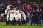 Sevilla players celebrate after securing unlikely comeback against Liverpool