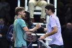David Goffin (L) and Roger Federer