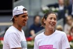 Rafael Nadal (L) and Garbine Muguruza