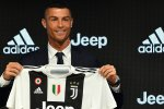Cristiano Ronaldo holding Juventus jersey