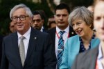 British Prime Minister Theresa May (R) meets European Commission President Jean-Claude Juncker in London on April 26.