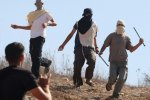 Masked settlers attacking the activists