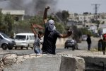 Protesters hurled stones at Israeli military vehicles.