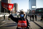 "A protester, whose sign reads ""Impeachment"", attends a rally in Seoul, South Korea, on Feb. 25."