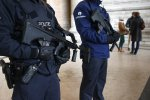 Belgian police officers guard a public building in Brussels.