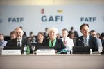 FATF President Juan Manuel Vega-Serrano (L) and IMF President Christine Lagarde (C) attended the plenary meeting in Valencia, Spain.