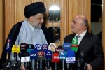 Iraqi Prime Minister Haider al-Abadi (R) attends  a press conference with Iraqi Shia cleric and leader Muqtada al-Sadr in Najaf on June 23.