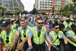 Police escort far-right demonstrators during a rally at Lafayette Park  opposite the White House, on August 12.