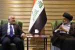 Iraqi Shia cleric Muqtada al-Sadr (R) speaks with Iraqi Prime Minister Haider al-Abadi in Baghdad, Iraq on May 19.
