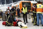 An injured passenger is attended to on the platform of a train station in Barcelona, Spain, July 28.