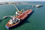 Oil prices fell on Monday after China threatened duties on American crude imports in a trade dispute with Washington.