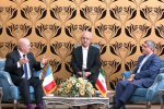 French Finance Minister Michel Sapin (L) in talks with his Iranian counterpart, Ali Tayyebnia (R), in Tehran on March 4, after meeting with Foreign Minister Mohammad Javad Zarif earlier in the day.