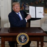 President Donald Trump signs a presidential memorandum on the Iran nuclear deal on May 8.