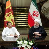 Iranian President Hassan Rouhani (R) meets with his Sri Lankan counterpart, Maithripala Sirisena, in Tehran on Sunday.