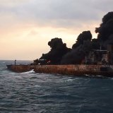 The Sanchi tanker ablaze in open waters after colliding with a Chinese bulk ship.