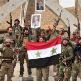 Syrian Government forces celebrate their victory over terrorists in Idlib in January.