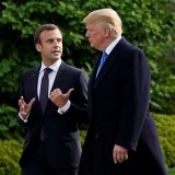 US President Donald Trump and French President Emmanuel Macron walk from the Oval Office of the White House on April 24.