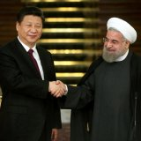 Iran's President Hassan Rouhani (R) and his Chinese counterpart Xi Jinping shake hands at the conclusion of a press conference in Tehran on Jan. 23, 2016.