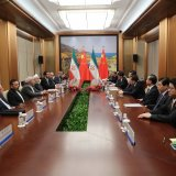 Top-level Iranian and Chinese officials confer as part of meetings that led to the signing of four major MoUs in Qingdao.
