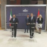Iran's Minister of Industries, Mining and Trade Mohammad Shariatmadari (L) and Serbian Minister of Trade, Tourism and Telecommunications Rasim Ljajic (2nd R) address a press conference in Belgrade on June 21.