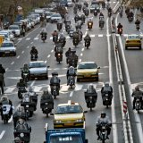 Due to Tehran's heavy traffic snarls, many prefer to take a motorcycle instead of a taxi.