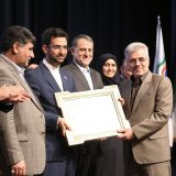 ICT Minister Mohammad Javad Azari-Jahromi (3rd L) presented an award to Hossein Fallah Josheqani, the head of Communications Regulatory Authority, in Tehran on March 12.