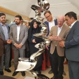 Tony Cragg (2nd R) explains about one of his sculptures in San'ati Museum of Contemporary Art in Kerman.