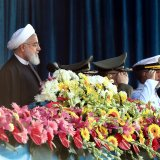 President Hassan Rouhani watches a military parade to mark National Army Day in Tehran on April 18.
