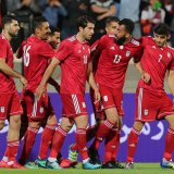 Team Melli players celebrate the goal.