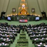 A handout picture provided by the office of Iranian President Hassan Rouhani on October 29 shows him delivering a speech to the parliament in Tehran.