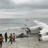 People pull the wreckage of crashed cargo plane on Oct. 14.