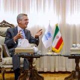 Abdolreza Rahmani-Fazli (R) talks with United Nations High Commissioner for Refugees Filippo Grandi in Tehran on Sunday.