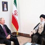 Leader of Islamic Revolution Ayatollah Seyyed Ali Khamenei (R) meets with Russian President Vladimir Putin in Tehran on Friday.