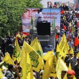 Marchers in Tehran take to the streets on  June 23 to mark International Quds Day.