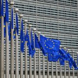 EU flags fly in front of its headquarters in Brussels.