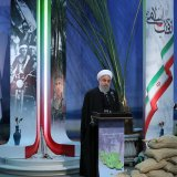 President Hassan Rouhani speaks at a ceremony in Tehran on Feb. 4 to inaugurate cultural centers and war museums across the country.