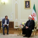 British Foreign Secretary Boris Johnson (L) meets President Hassan Rouhani in Tehran on Dec. 10.