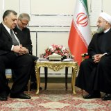Speaker of People's Council of Syria Hammouda Youssef Sabbagh (L) meets President Hassan Rouhani in Tehran on Jan. 16.