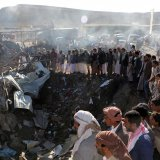 People gather at the site of an airstrike in the northwestern city of Saada, Yemen, November 1.