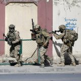 Afghan and foreign security forces arrive at the site  of the attack in Kabul, Afghanistan, November 7.