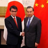 Japanese Foreign Minister Taro Kono (L) and Chinese counterpart, Wang Yi, pose for photograph before their meeting in Beijing on Jan. 28.