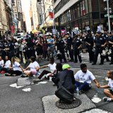 Protestors sit on Fifth Avenue in front of Trump Tower to speak out against the administration's decision  to end the DACA program on Sept. 5.